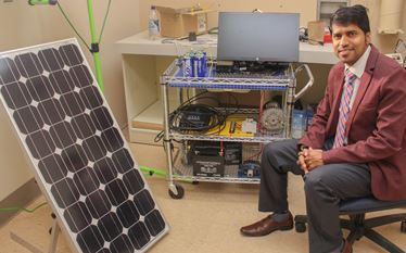 Dr. Eklas at his laboratory with equipment for his project on the second life battery project funded by Portland General Electric
