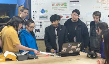 Dr. Hossain teaching the students of Mazama High about the principals of robots