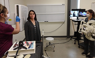 TAs position patient for virtual technologist
