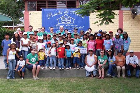 Dental hygiene students Stand outside with staff and kids from Posada de Amor orphanage